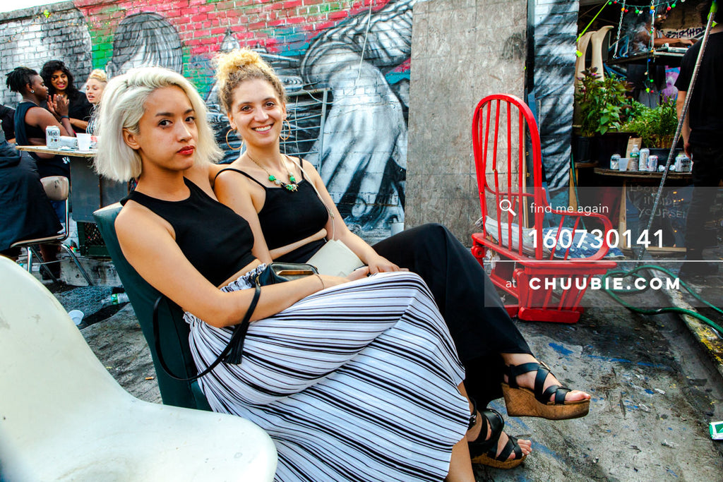 160730141 | Two stylish elegant girls, blond hair, with graffiti wall on Brooklyn summer rooftop. — Sublimate... | Team Chuubie