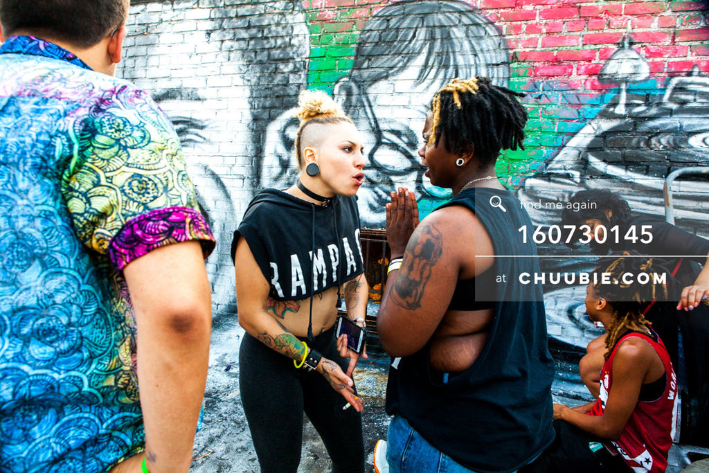 160730145 | Two queer punk girls serving us attitude with graffiti wall. — Sublimate & Ruse Labs present:... | Team Chuubie