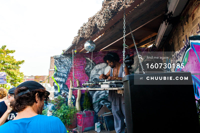 160730185 | Turtle Bugg (Tajh Morris) DJing Brooklyn summer rooftop; graffiti wall disco ball. — Sublimate &a... | Team Chuubie