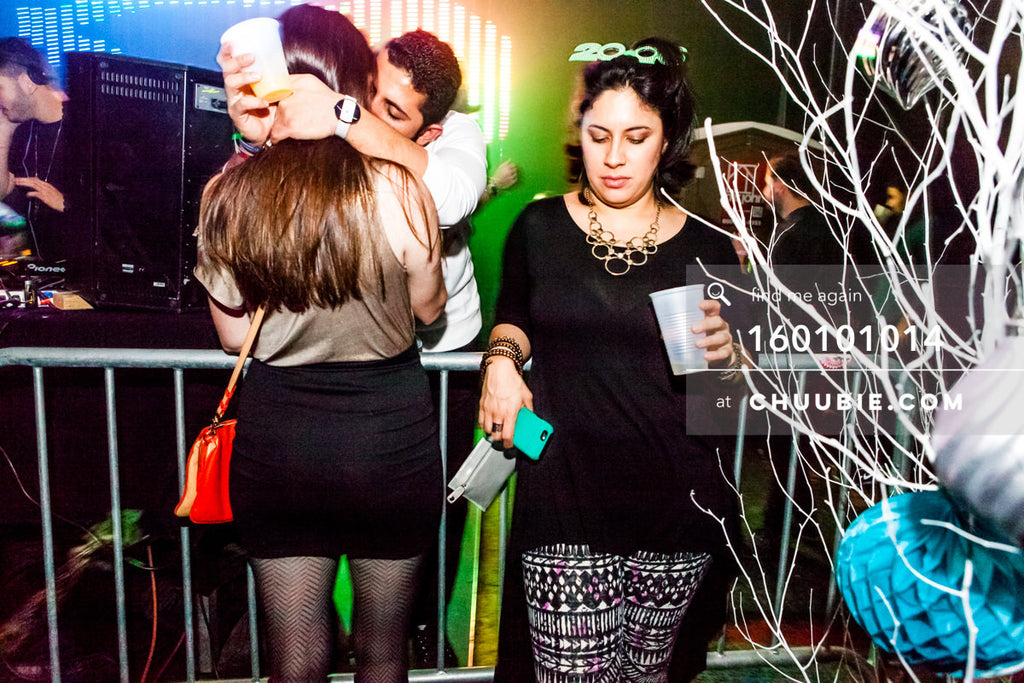 160101014 | Couple kisses (left) and DJ Carol Ferraz (right) at New Year 2016 Brooklyn warehouse party.  —Tal... | Team Chuubie