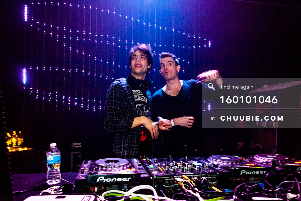 160101046 | Clarian and partygoer behind DJ booth w/ LED light wall —Tal Ohana's ZigZag Deep NYC. New Year 20... | Team Chuubie