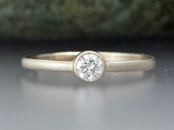 White Sapphire Solitaire Engagement Ring with a  Straight Bezel and a Slim 1.5mm Half Round Band, 3-6mm Sapphire in Gold or Platinum