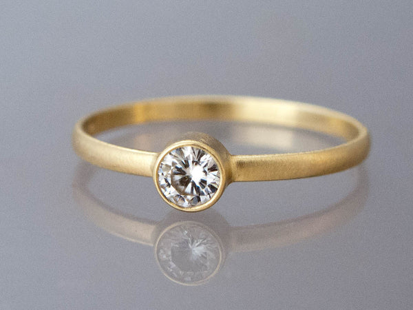 Solitaire Moissanite Engagement Ring with a Delicate 1.5mm Half Round Band and 3mm-6mm Straight Bezel in Gold or Platinum