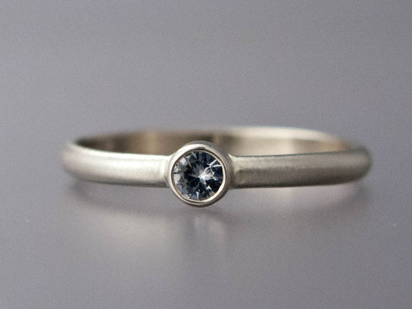 Solitaire Engagement Ring with a 3mm-6mm White Sapphire in a Straight Bezel and a Classic 2mm Half Round Band in Gold or Platinum