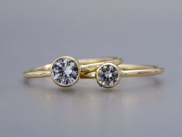 Moissanite Engagement Ring with a Delicate 1.3mm Round and 3mm-6mm Solitaire Straight Bezel in Gold or Platinum