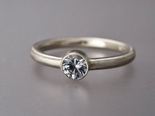 Solitaire Moissanite Engagement Ring with Straight Bezel and a Classic 2mm Round Band in Gold or Platinum | 3mm-6mm Lab Grown Diamond Alternative