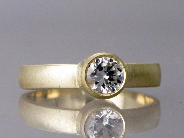 Moissanite Engagement Ring with a 3mm Wide Half Round Band and Straight Bezel in Gold or Platinum | Choice of 4mm-6mm Forever One Moissanite