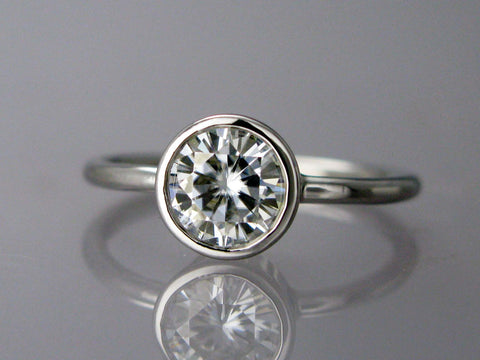 White Sapphire Engagement Ring | 4mm-6.5mm Solitaire Ring with a Tapered Bezel and 1.6mm Round Band in Gold or Platinum