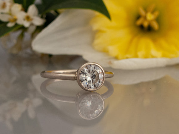 Moissanite Engagement Ring | 4mm-6mm Solitaire in a Tapered Bezel and 1.6mm Round Band in Gold or Platinum