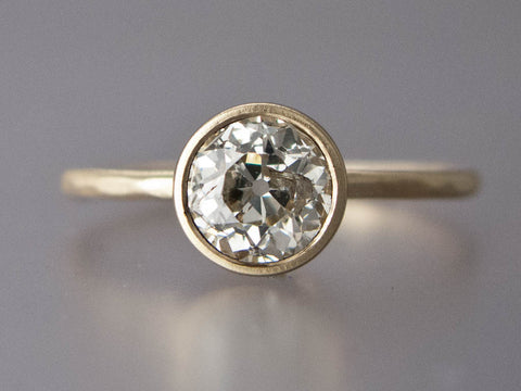 Moissanite Solitaire Engagement Ring with a Tapered Bezel and Delicate 1.3mm Round Band in Gold, or Platinum with a 3mm-6mm Ethical Gemstone