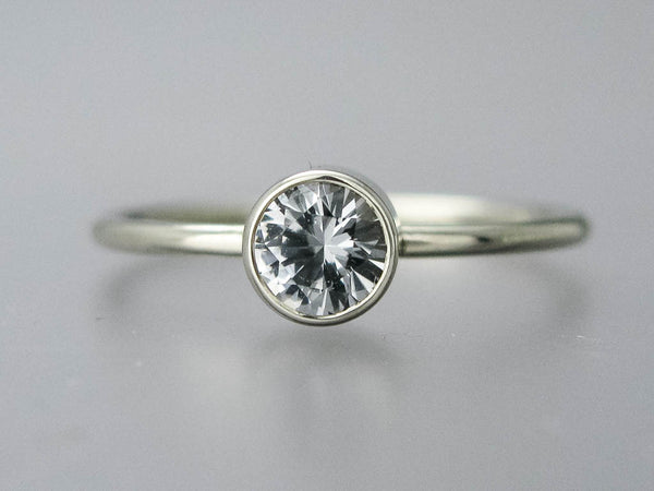 Moissanite Solitaire Engagement Ring with Stacked Bezel and a 1.3mm Round Band in Gold or Platinum , 3mm-6mm Lab Grown Diamond Alternative