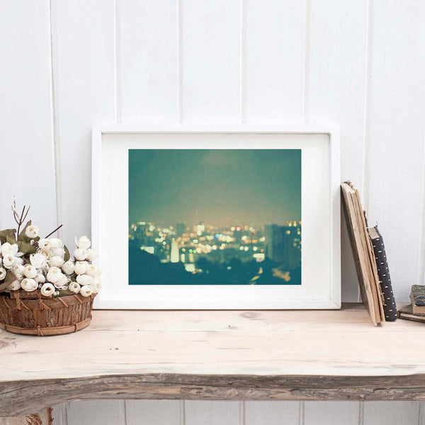 Framed Los Angeles cityscape photo, with colorful twinkly lights.