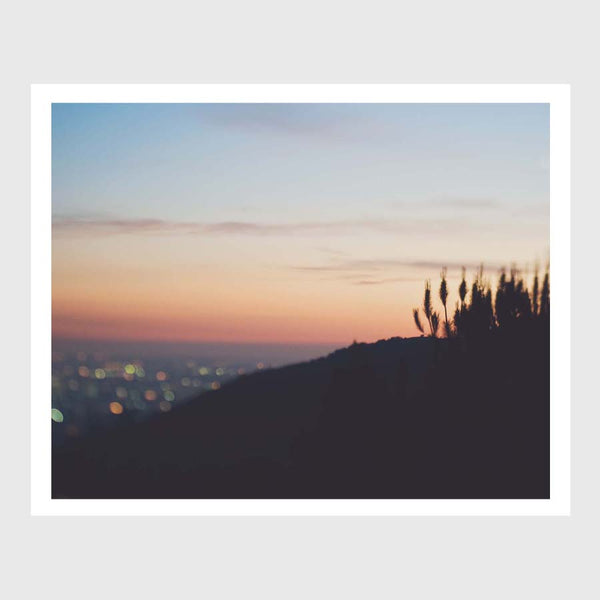 Sunset bokeh photograph of LA. Dreamy cityscape art print with a canyon silhouette.