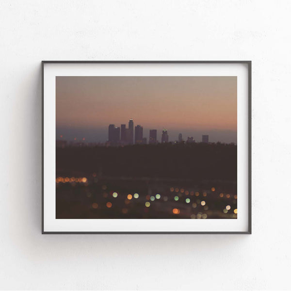 Framed print of the Los Angeles skyline at night . With Bokeh lights.