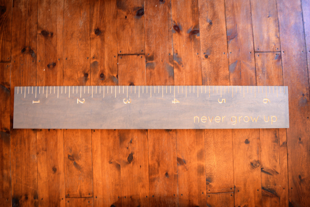 """Never Grow Up"" Growth Chart"