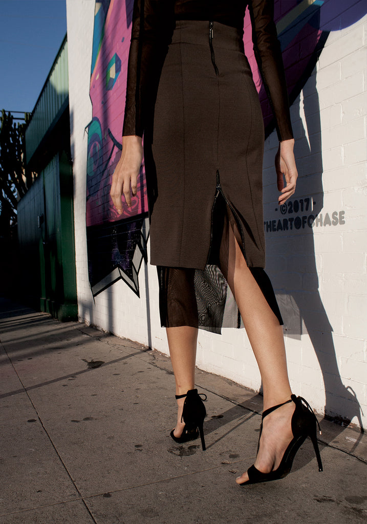 Black mesh statement skirt slip with back slit.
