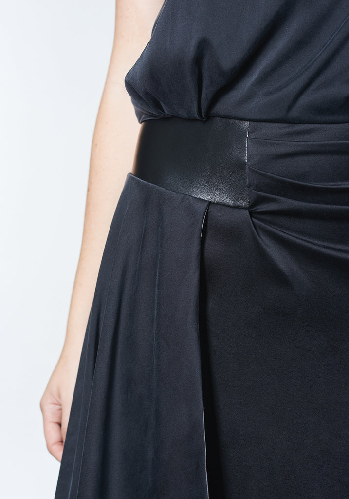 Black, stretch silk, fashion forward bridesmaid dress with sideswept draping.