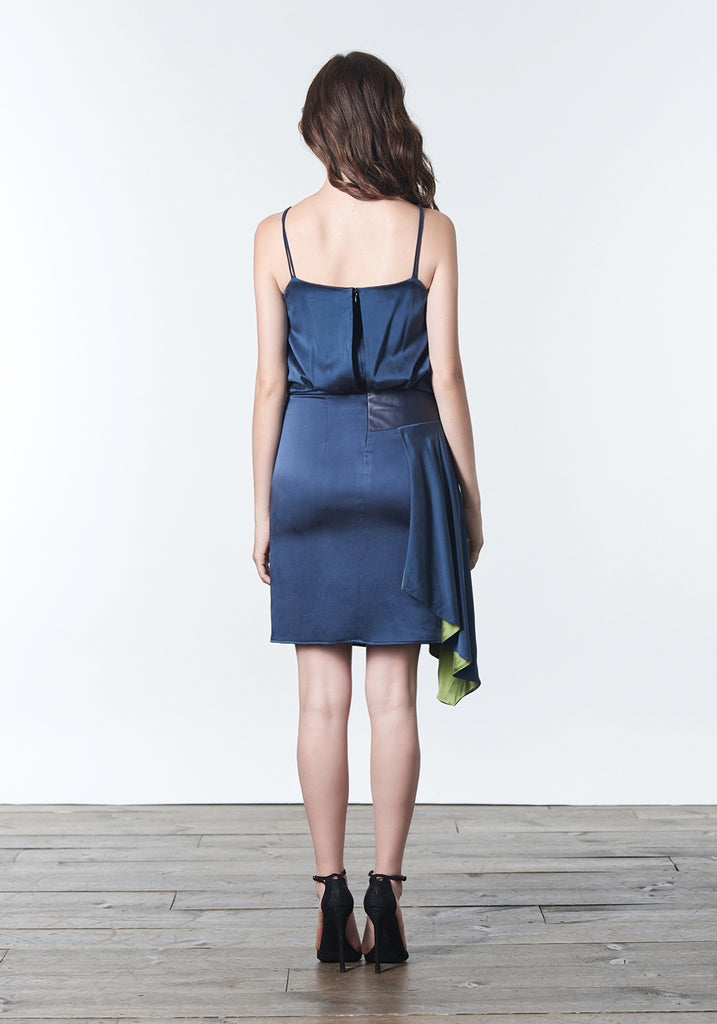 Dark peacock blue, stretch silk, fashion forward bridesmaid dress with sideswept draping.