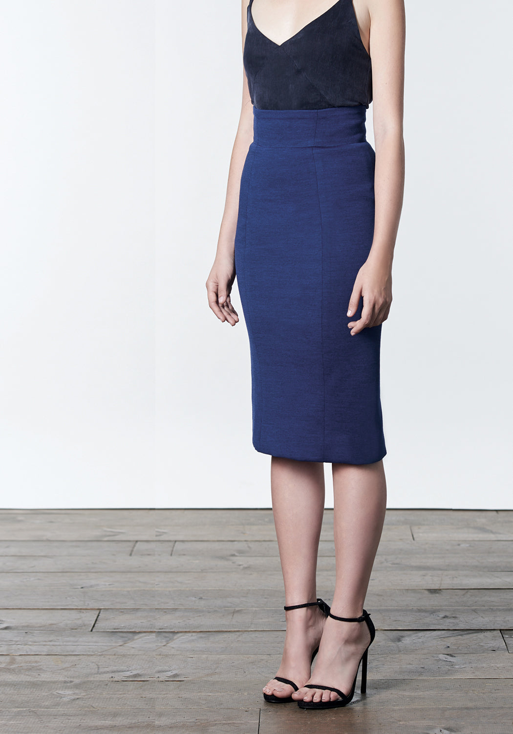 Blue wool tencel pencil skirt with back zipper details.