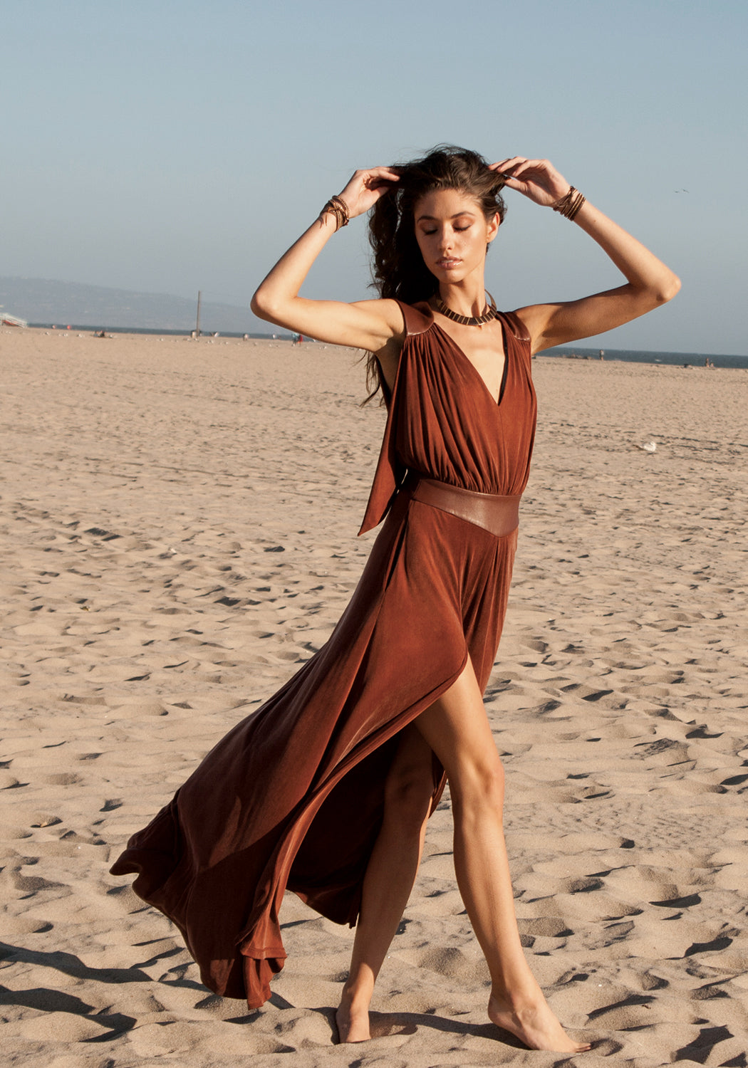 Long, winter maxi dress in brown, cognac color that can be dressed up and worn as a gown to black tie or other evening event or dressed down for daytime looks.