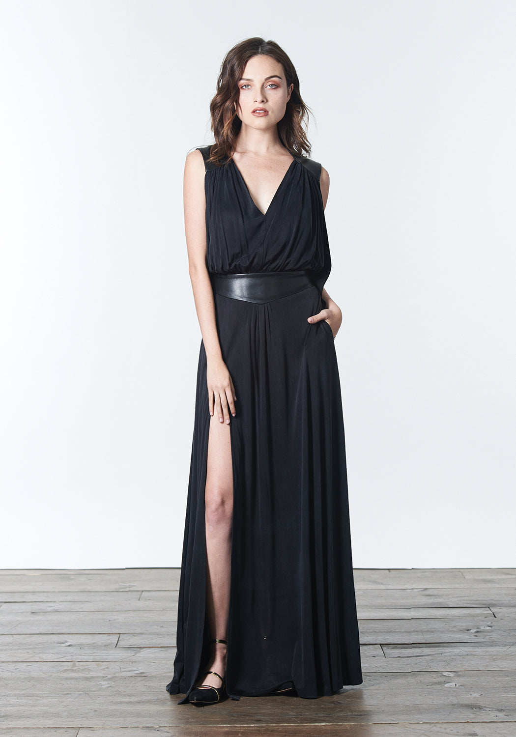 Long, winter maxi dress in soft black color that can be dressed up and worn as a gown to black tie or other evening event or dressed down for daytime looks.