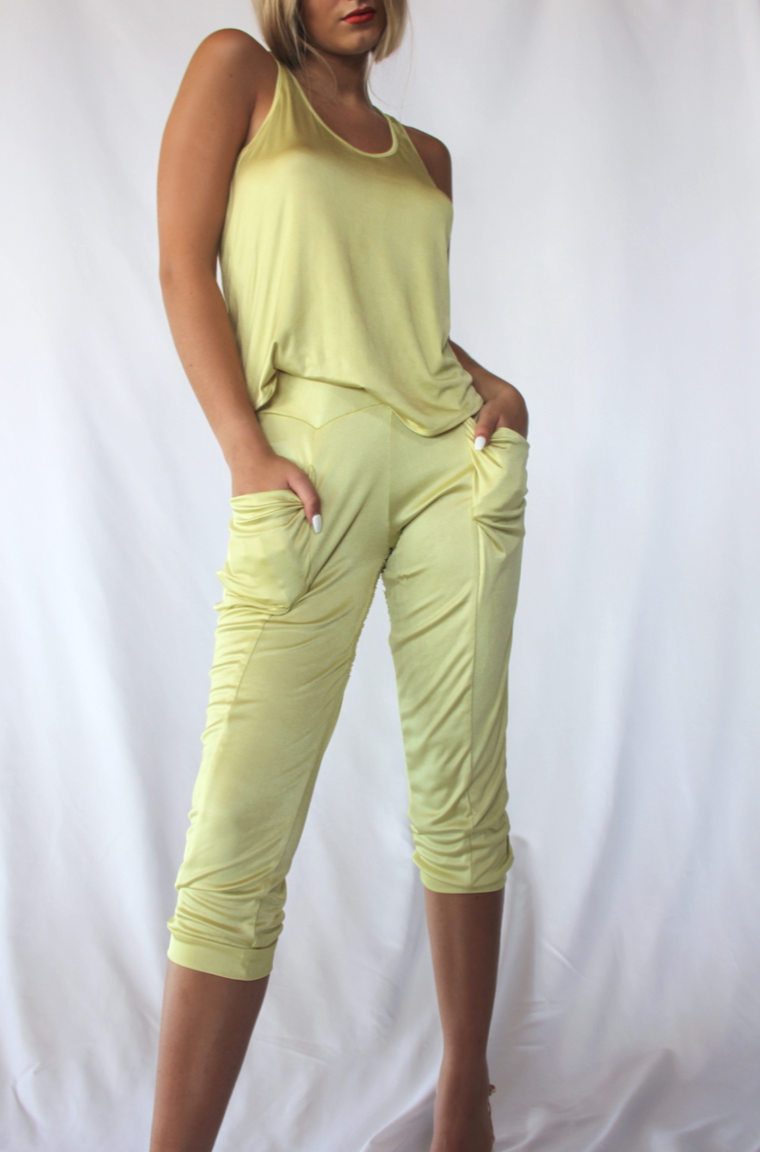 Yellow silky knit lounge pant and cowl halter top set.