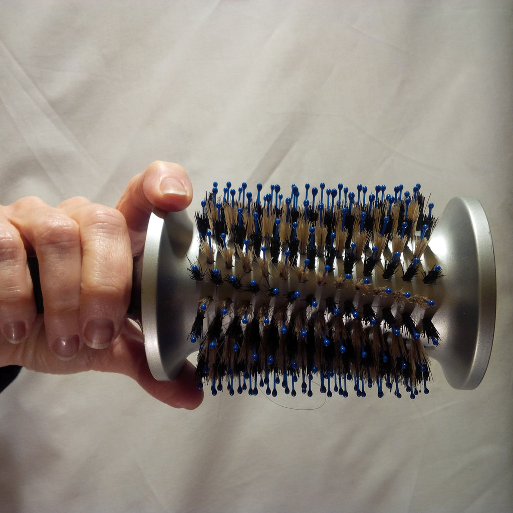 WOW FACTOR: BALANCE OF A HAIR BRUSH.