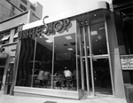 exterior of waffle shop in Washington DC. Diners can be seen through the large glass window.
