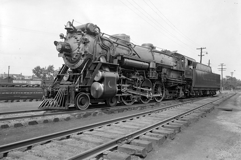 the southern crescent locomotive in 1917 for the southern railroad company. Train is sitting on tracks.