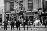 Horses with riders in the street outside the Reno bar in Billings Montana