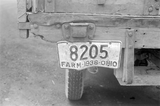 a 1938 ohio license plate hangs froma truck with plate number 8205