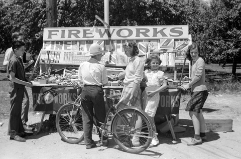 kids standing around a Fourth of July roadside firework stand near Milwaukee, Wisconsin