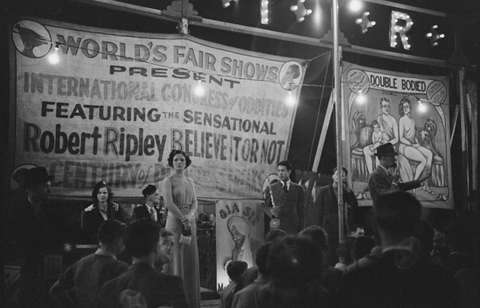 Outdoor carnival, Granville, West Virginia. Banner says Robert Ripley's Believe it or not