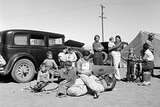 Four families, three of them related with fifteen children, from the Dust Bowl in Texas stay in an overnight roadside camp near Calipatria, California