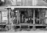 Sunday Afternoon, July 1939 - Gordonton, North Carolina showing a country store on dirt road. Check out kerosene pump on the right and the gasoline pump on the left. The brother of the store owner stands in doorway.