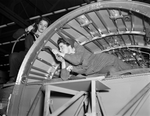 A girl team working on a center wing section of a B-24E