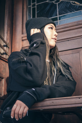 female artist aleta lee in the consttant black sammy hoodie