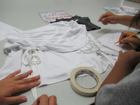 making final revisions to the second to last garment sample