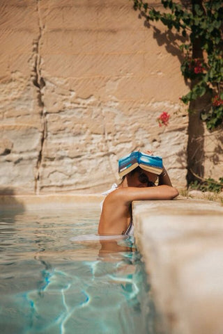 reading a book poolside