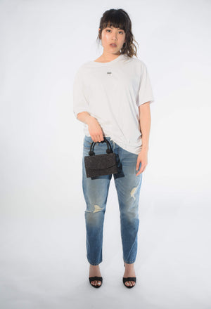 oversized womens top with boyfriend jeans black sparkle mini bag and blag heels