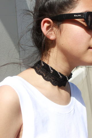 Consttant white tank top piece of clothing and lace velvet chain choker.