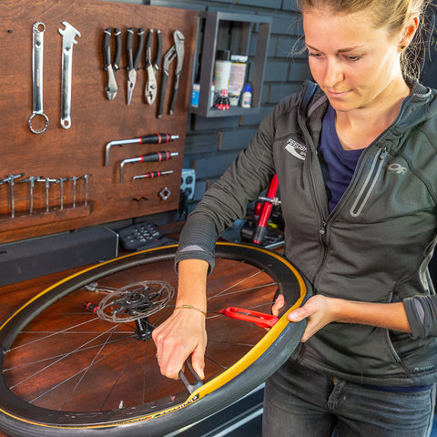 Female Mechanic Changing a Tyre with Feedback Sports Steel Core Tyre Lever – How to Change a Flat Bike Tyre