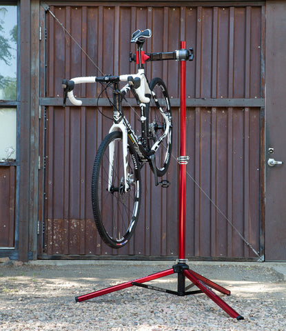 Feedback Sports  Pro Elite Repair Workstand Outdoors with Road Bike Mounted