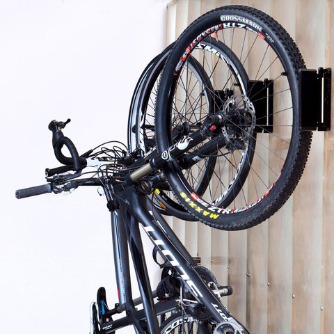 Feedback Sports Velo Hinge showing bicycles stored and pivoted towards wall