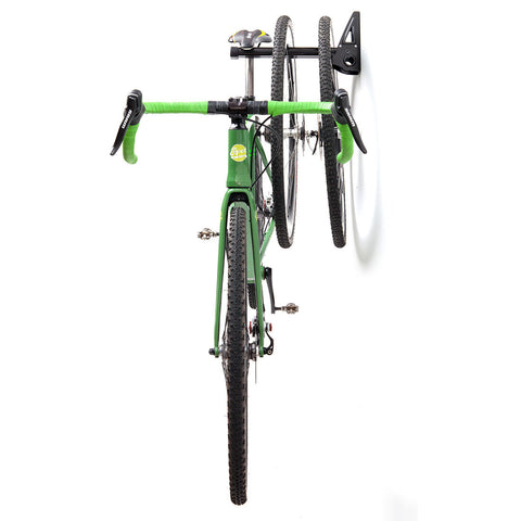 Feedback Sports Velo Wall Post Shown Holding Bicycle and Spare Wheels
