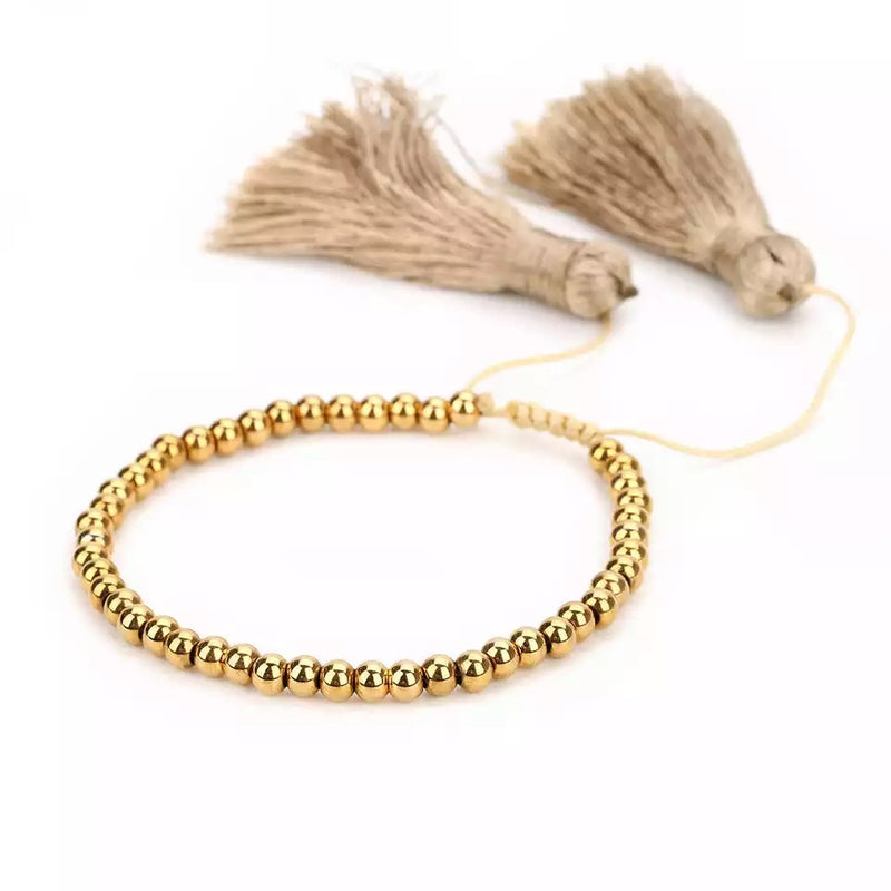 Shiny Round Gold Beads with Big Silk Tassels