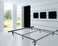 Metal bed frame on a white floor