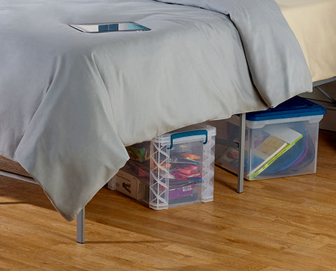 Storage under a platform bed adds space.