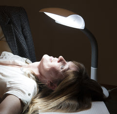 Woman under a SAD lamp