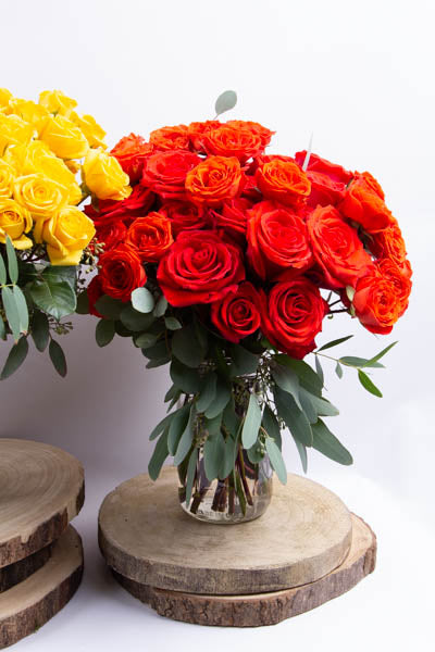 A Dozen Orange Roses and Co.